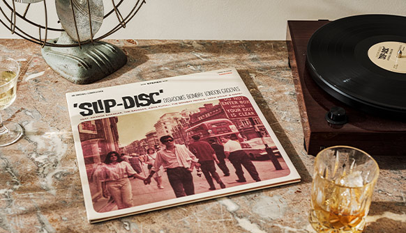Dishoom Slip-Disc LP Vinyl next to a record player