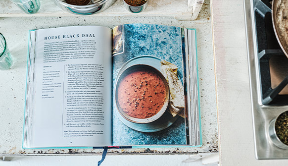 Dishoom From Bombay with Love Cookery Book open at Black Daal page