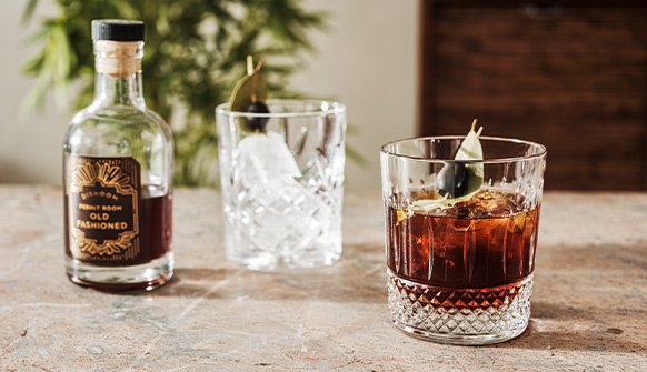 Dishoom Permit Room Old Fashioned served in a glass with Bay Leaf