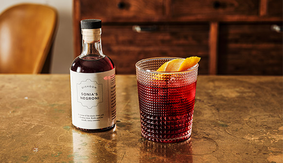 Dishoom Sonia's Negroni served in a glass with orange
