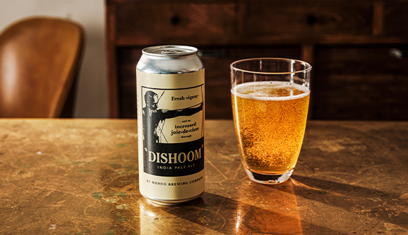 Can of Dishoom India Pale Ale and Glass